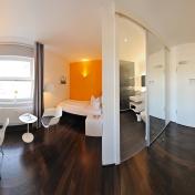V8Hotel - Die Einzelzimmer. V8 HOTEL - MOTORWORLD Region Stuttgart auf dem Flugfeld Boeblingen.